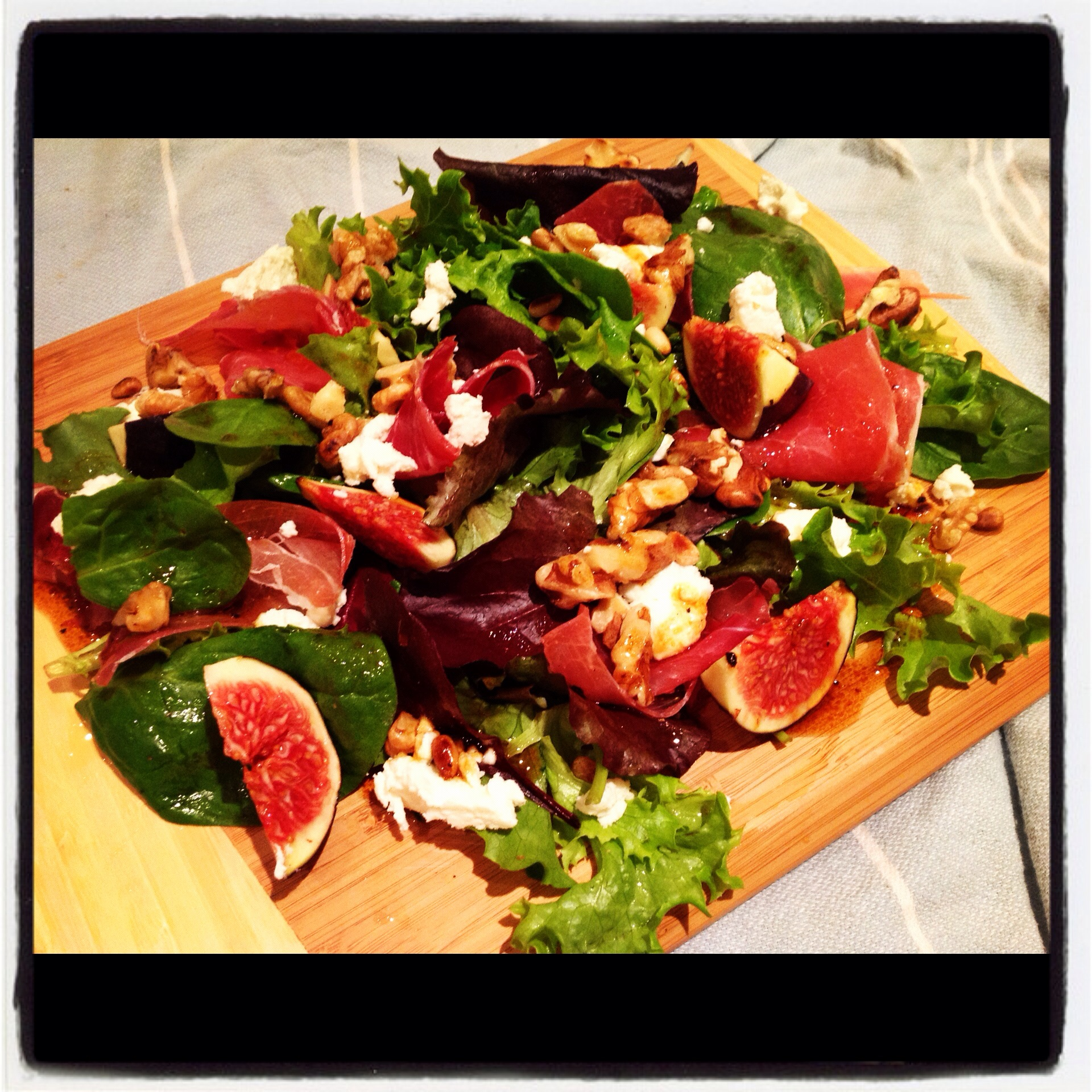 Fig, walnut, Serrano ham and goat's cheese salad with a pomegranate ...